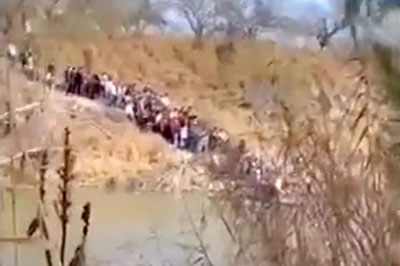 Biden's open border hell: Cartels toss flimsy rafts, some with infants on them, into the Rio Grande