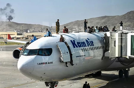 'A big change has come': Kabul airport reopens but flights leave empty as Taliban blocks access