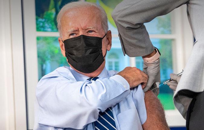 Biden takes Covid booster — on a fake White House set