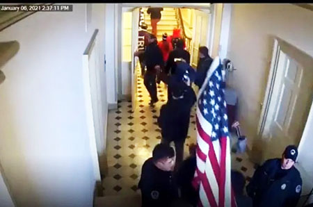 Video, which Biden's DOJ tried to block, shows Capitol Police waving in hundreds on Jan. 6